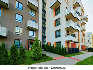 Apartment residential modern house building exterior and fence. New home concept.