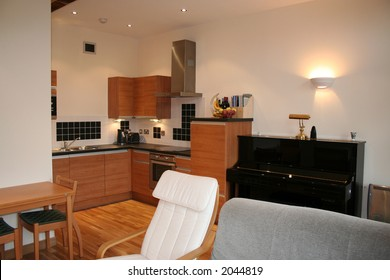 Apartment showing kitchen diner interior and an upright piano
