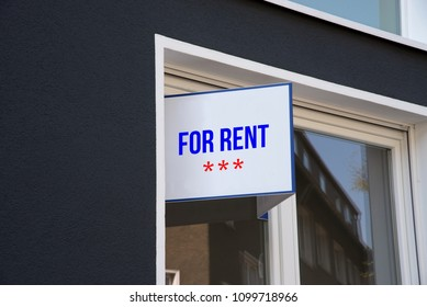 An Apartment And A Sign For Rent