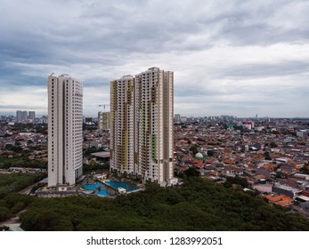 Apartment tower and the large middle class traditional residential area in Jakarta, Indonesia. Jakarta is one of the largest city in the world and overcrowded.