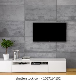 Apartment with tv, white cabinet and concrete wall