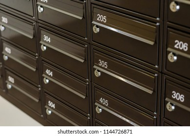 Apartments letter boxes close up. City flats entrance hall mailboxes.