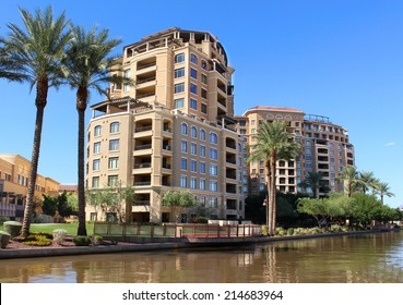 Apartments on river walk with palm trees in an upscale neighborhood