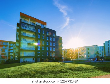 Apartments residential house facade architecture with outdoor facilities. Blue sky on the background. With sunlight