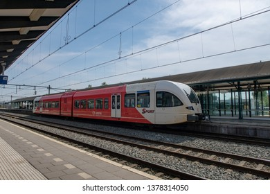 Apeldoorn, Gelderland / the Netherlands - 04 23 2019: A train from traincompany Arriva at the platform. This type of train is a sprinter called the Spurt.