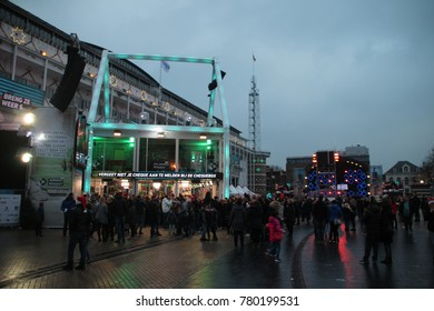 Apeldoorn, Netherlands -December 23, 2017:  3 DJ's of NPO 3FM radio are locked up 6 days in house of glass without food to raise mony for the Red Cross : Serious Request house on the marktplein Square