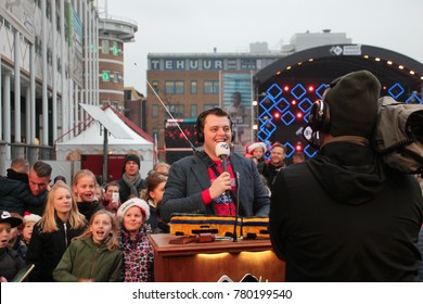 Apeldoorn, Netherlands - December 23, 2017:  3 DJ's of NPO 3FM radio are locked up 6 days in house of glass without food to raise mony for the Red Cross :DJ works as  auctioneer for Serious Request