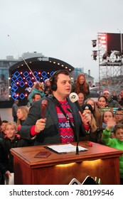 Apeldoorn, Netherlands - December 23, 2017:  3 DJ's of NPO 3FM radio are locked up 6 days in house of glass without food to raise mony for the Red Cross :DJ works as mobile auctioneer -serious request