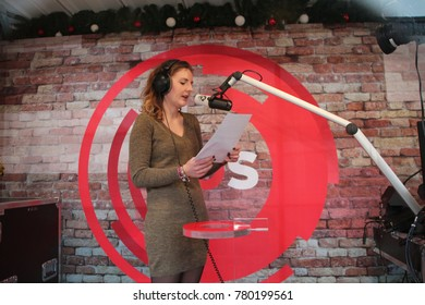 Apeldoorn, Netherlands - December 23, 2017:  3 DJ's of NPO 3FM radio are locked up 6 days in house of glass without food to raise mony for the Red Cross :  news bulletin red by Kirsten Klomp Serious