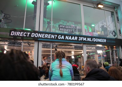 Apeldoorn, Netherlands - December 23, 2017:  3 DJ's of NPO 3FM radio are locked up 6 days in house of glass without food to raise mony for the Red Cross : several tents on the square in Apeldoorn