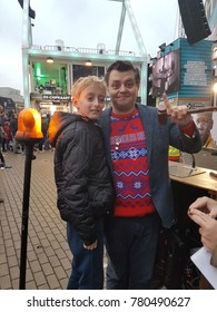 Apeldoorn, Netherlands - December 23, 2017:  3 DJ's of NPO 3FM radio are locked up in house of glass to raise mony for the Red Cross serious request  : boy with DJ Rob Janssen