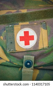 APELDOORN, THE NETHERLANDS - JULY 5, 2018: Red cross medical aid symbol on a vintage jute army bag on a local antiques market in Apeldoorn, The Netherlands