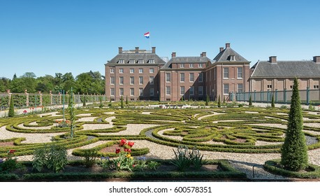 Apeldoorn, The Netherlands, May 8, 2016: Dutch baroque garden of The Loo Palace , a former royal palace and now a national museum located in the outskirts of Apeldoorn in the Netherlands