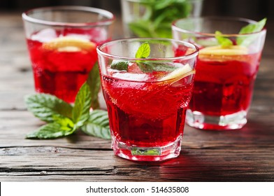 Aperitif with campari, mint and lemon, selective focus
