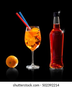 Aperol spritz bottle with orange and straw, isolated on black