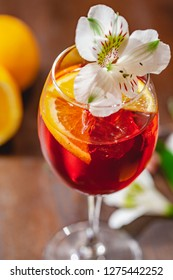 Aperol spritz cocktail decorated with flower. Close up
