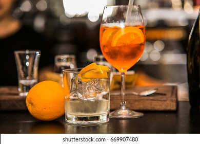 Aperol Spritz cocktail with ice in the bar background