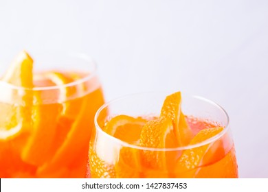 Aperol Spritz cocktail with mint leaves on a white background. Italian cocktail aperol spritz on white