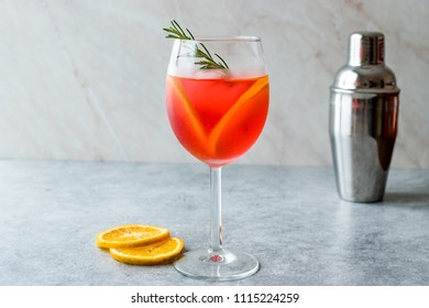 Aperol Spritz Cocktail with Orange Slice, Rosemary and Ice.