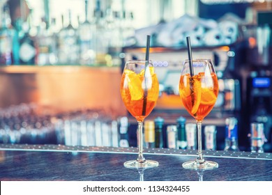 Aperol spritz drink on bar counter in pub or restaurant.