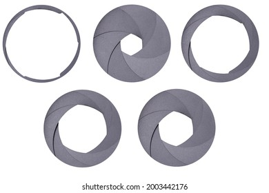 Aperture blades used in a camera lens. Different value of the aperture opening in the optical system. Isolated background.