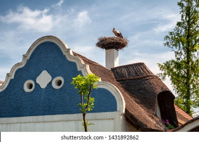 APETLON/ AUSTRIA JUNE 2019: Traditional House and facade with stork nest on Roof in Apetlon Burgenland