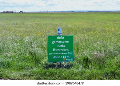 Apetlon, Burgenland, Austria- May 18, 2021: Board showing the lowest measured point in Austria - board description: lowest measured point in Austria at the intersection of the roads, height 114 meters