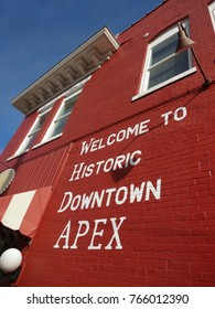 APEX, NORTH CAROLINA - APRIL 2015: Town sign painted on a brick wall welcoming all to Historic Downtown