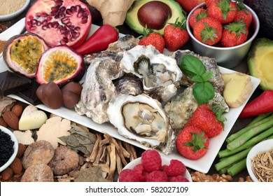 Aphrodisiac food for good sexual health with foods forming a background.