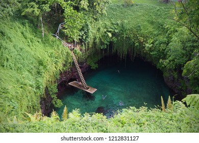 Apia, Samoa - May 7 2018: Crystal clear waters of the swimming hole, To Sua Ocean Trench (Lotofaga) in Samoa, Pacific Islands