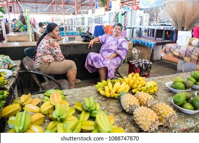 Apia, Samoa - October 27, 2017: female stallholders selling fruit at Fugalei fresh produce market