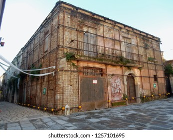 Apice, Benevento, Campania, Italy - December 2018: Palace caged with a metal structure to prevent its collapse in the ghost village of Apice Vecchia