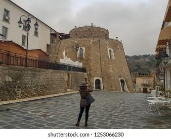 APICE VECCHIO, ITALY - 03 DECEMBER 2018: a tourist take a picture in Apice Vecchio, province of Benevento.