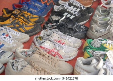 Apin-Apin, Sabah, Malaysia. December 18, 2016: Pre-loved or second hand shoes displayed for sale at a local weekly market. Second hand items are usually in a good condition and sold at lower price.