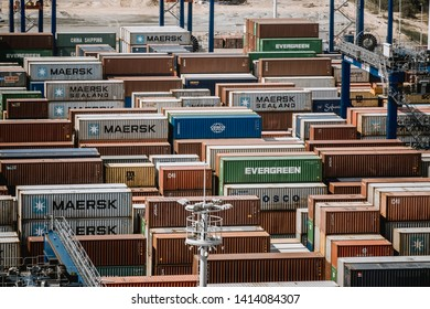 APL, Maersk, Hamburg SUD and China shipping containers stacked in DCT container terminal in Gdańsk - the biggest container port in Baltic Sea. Gdansk, Pomerania / Poland - May 19 2019.