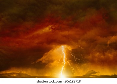Apocalyptic dramatic background - lightnings in dark red sky, judgment day, armageddon