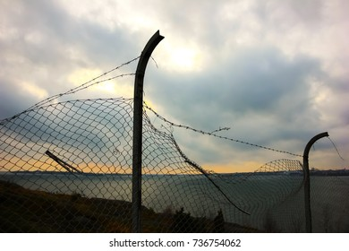 Apocalyptic scene of a barbed wire fence and the horizon