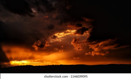 Apocalyptic sunset with fire clouds