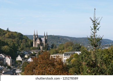 Apollinaris church, on the site of a Roman temple on the Apollinarisberg, a hill above the German town of Remagen. Autumnal landscape.