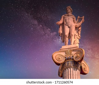 Apollo the ancient Greek god of poetry and music under starry night sky, Athens Greece