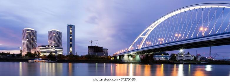 Apollo bridge over river Danube and highrise buildings. Bratislava, Slovakia. Panorama 3:1