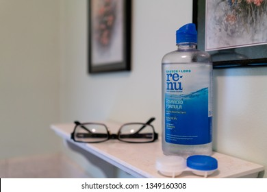 Apollo, PA/USA - 3.25.2019: Bausch & Lomb re-nu contact solution with glasses and contact lens case in an American bathroom.