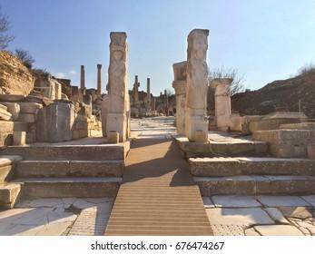 Apollo Roman Pillars at fallen Temple Door with statue decorated stone in ephesus Archaeological site in turkey