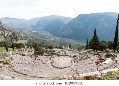 Apollo Temple in Delphi and ancient theatre, an archaeological site in Greece, at the Mount Parnassus. Delphi is famous by the oracle at the sanctuary dedicated to Apollo. UNESCO World heritage