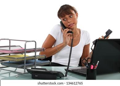 Apologetic secretary on the phone
