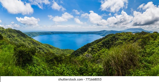 Apoyo Lagoon captured as a panorama & seen from Mirador de Catarina.  Lake Nicaragua, the 19th largest lake in the world can be seen in the distance.