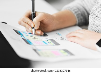 app design, technology and business concept - web designer working on user interface and creating layout at office