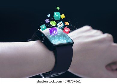 App icons with smartwatch. A smartwatch is a wearable computing device that closely resembles a wristwatch or other time-keeping device.