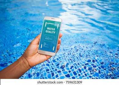 App measuring water quality on the screen of smartphone in front of the swimming pool