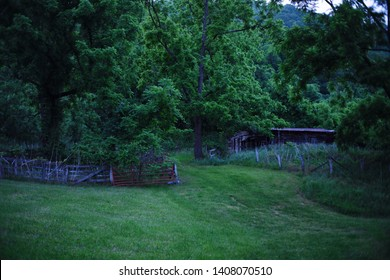 An Appalachian home sits in the mountains of western North Carolina surrounded by lush grass and luxurious nature.